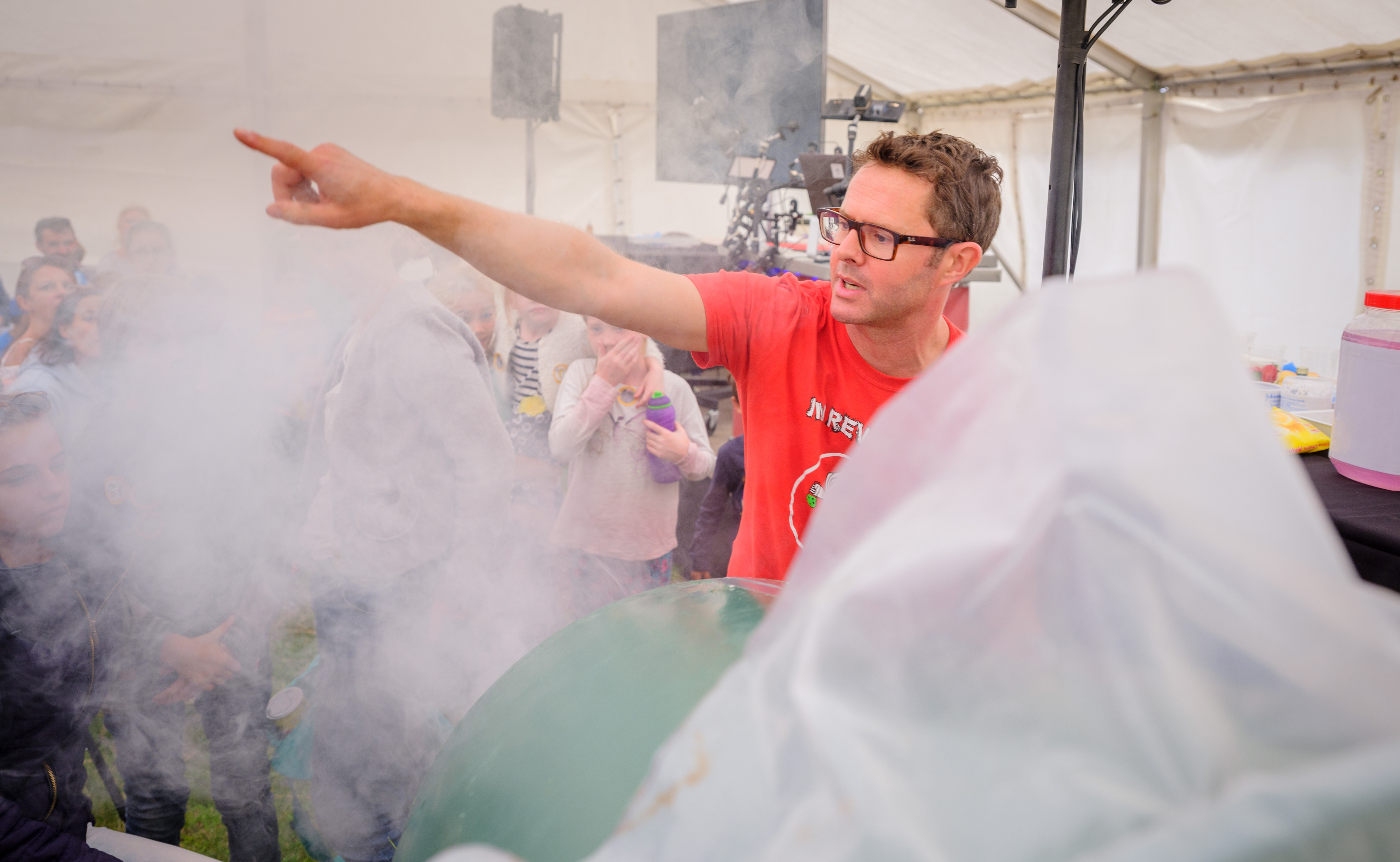 TV presenter Stephan Gates performs a science experiment at the Wakehurst festival