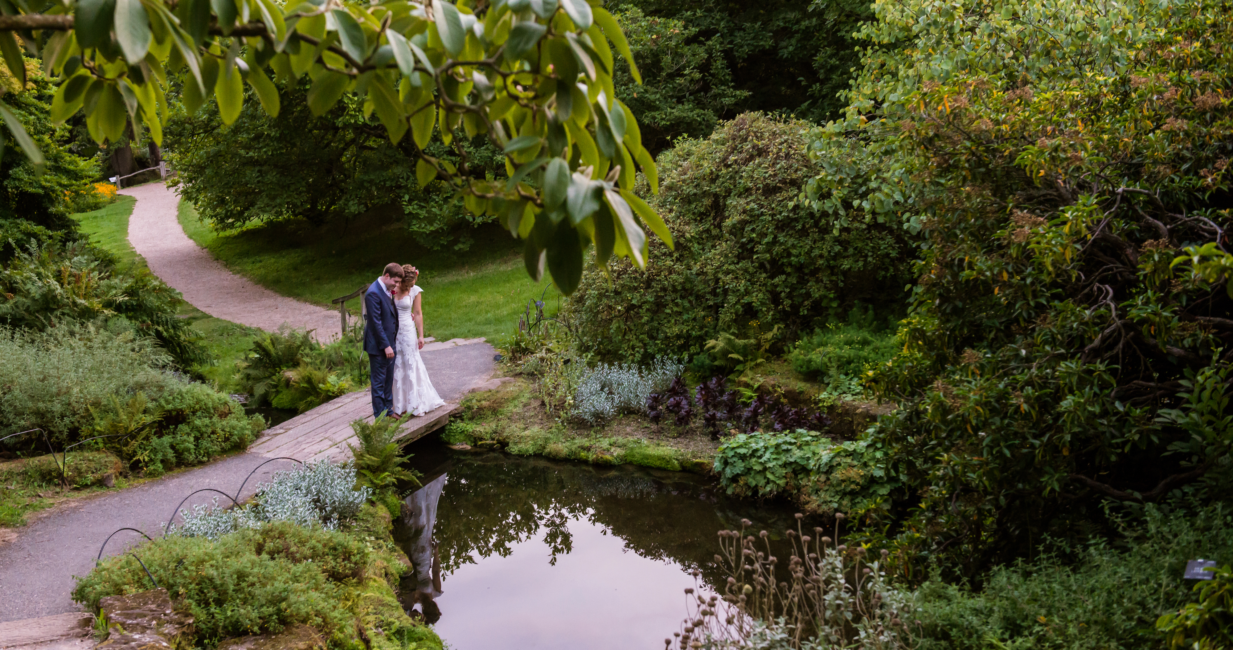 A bride and groom in the Wakehurst grounds