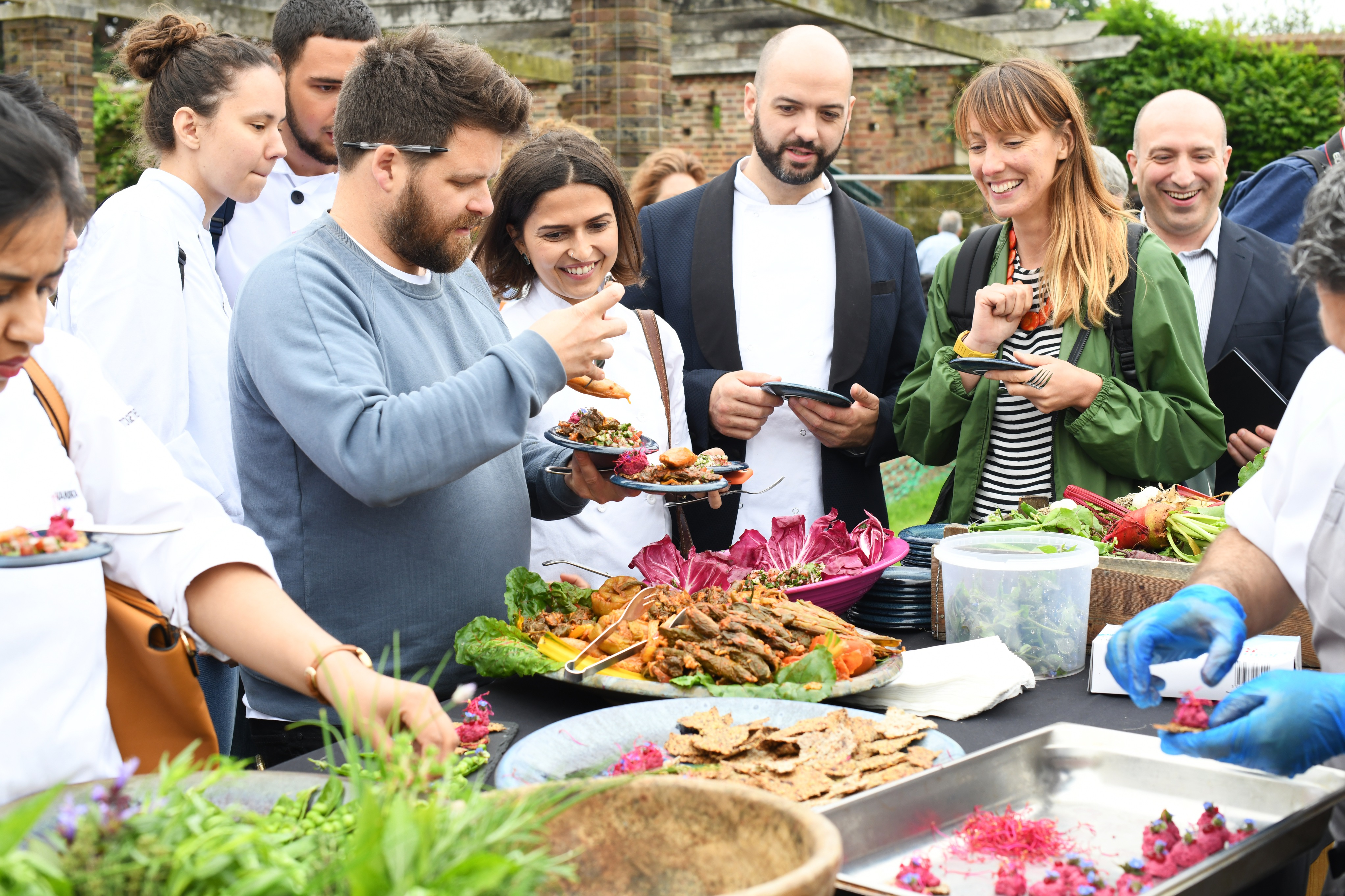 The chefs sampling food in the Kitchen Garden