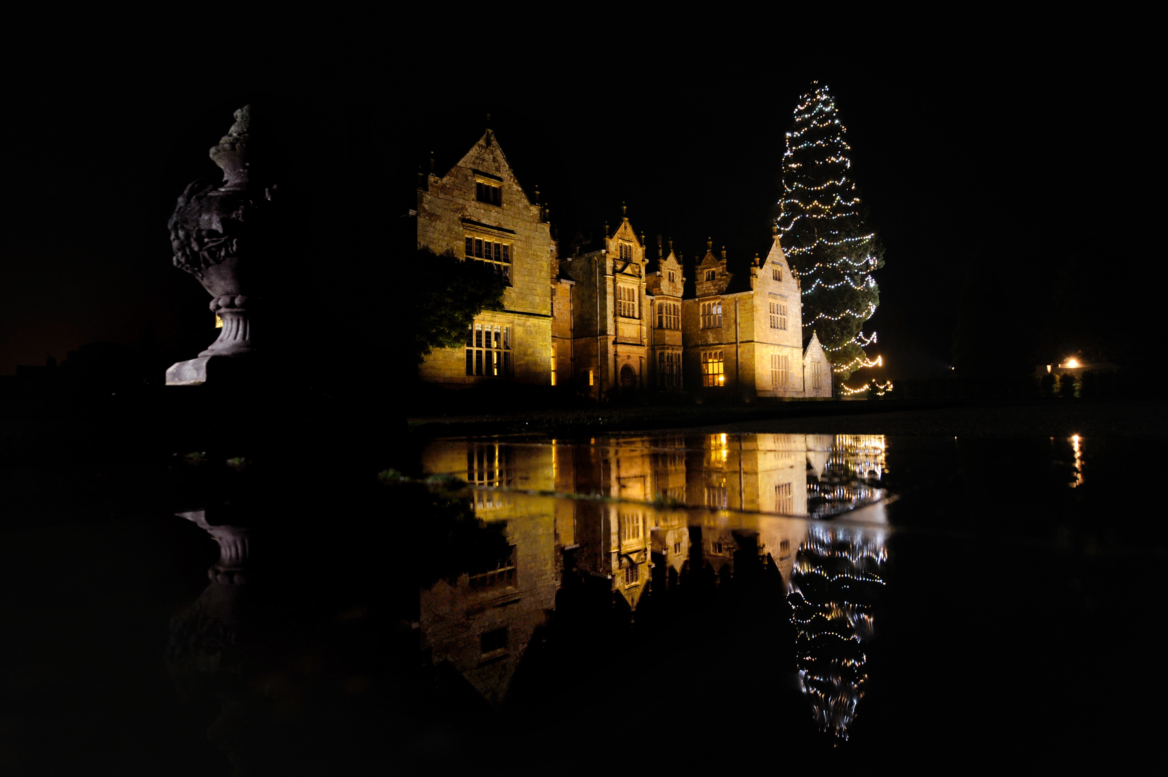 Wakehurst Mansion illuminated during Glow Wild at night