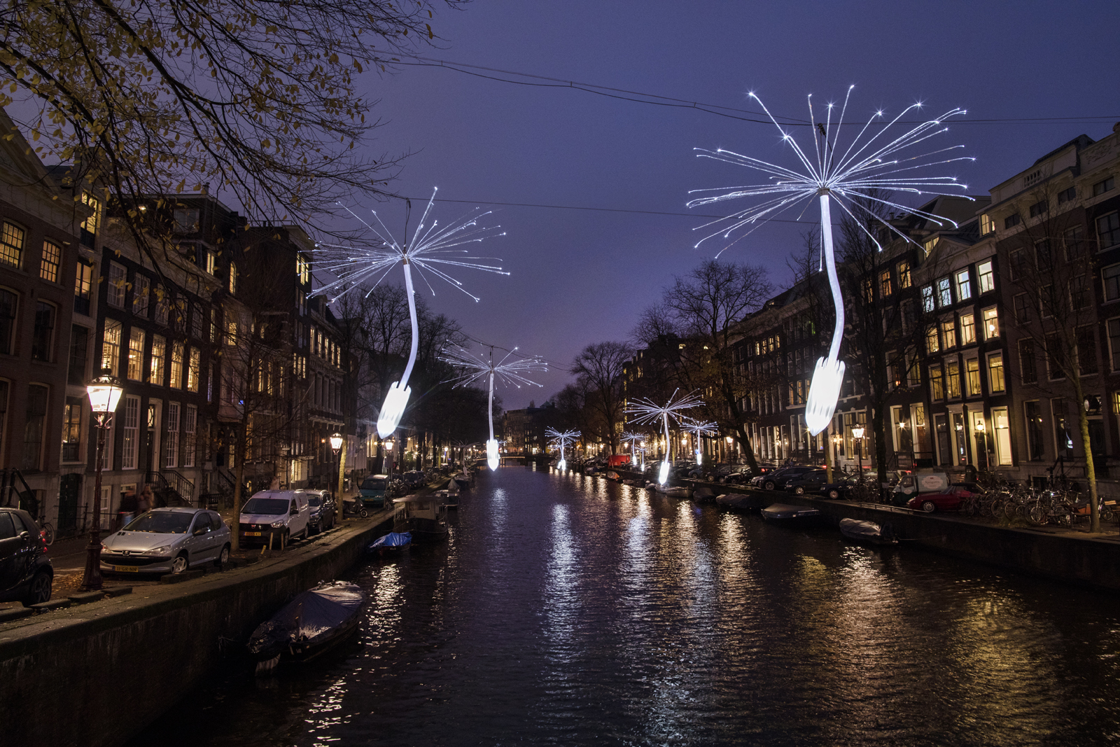Giant, sparkling dandelion seed heads over Amsterdam's canals