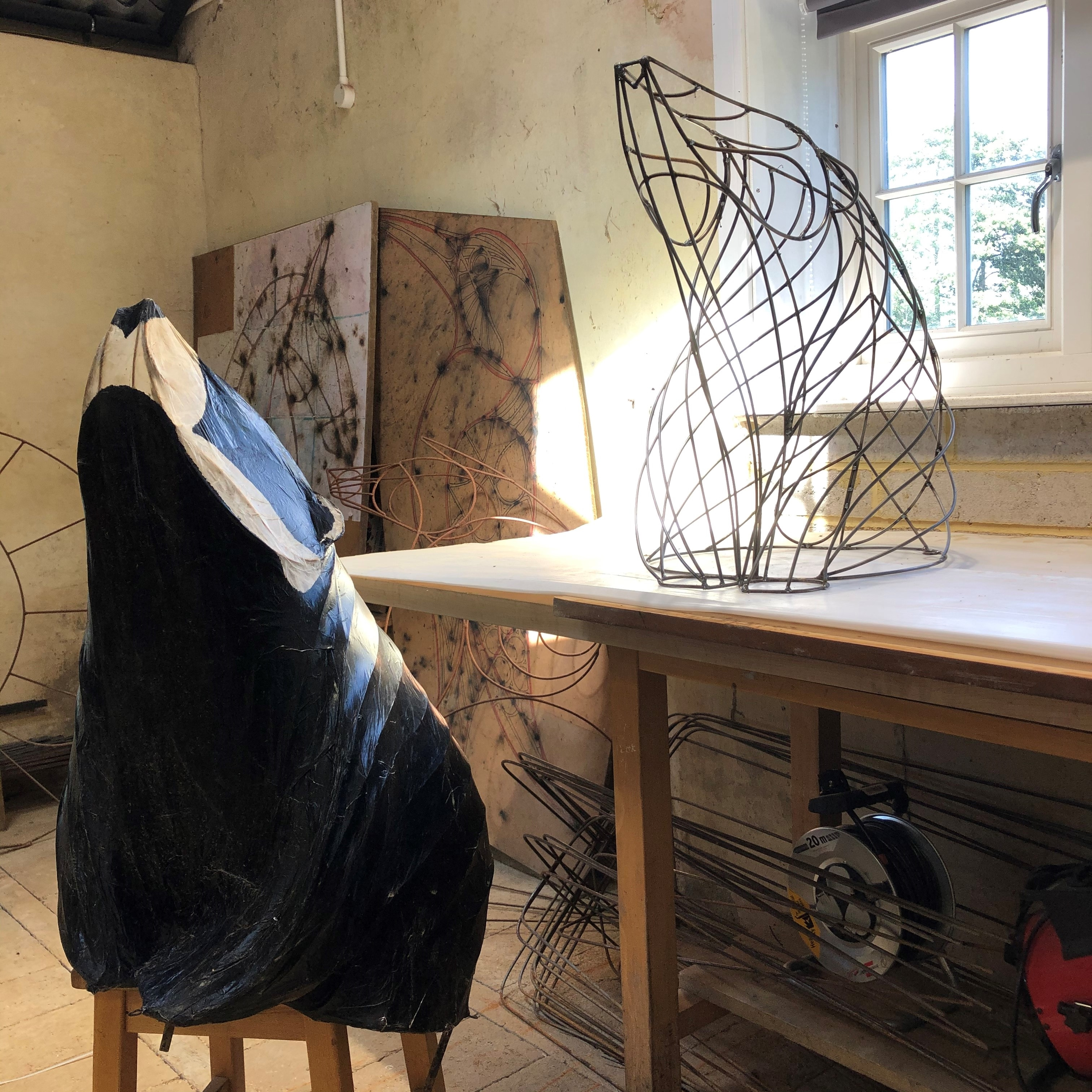 The making of black and white, wire and paper badger lantern