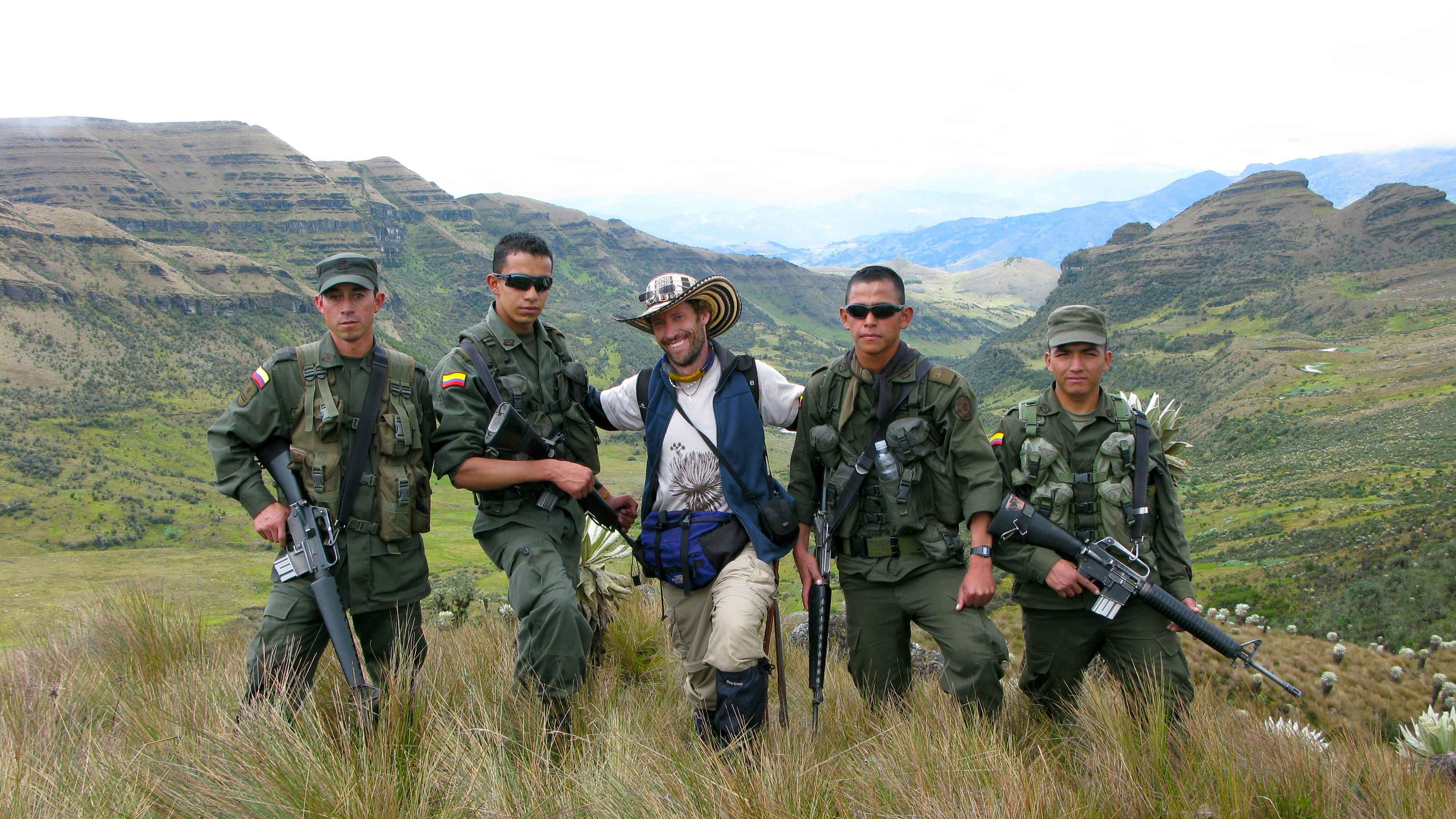 Image showing Mauricio carrying out fieldwork in 2011 with protection by Colombian soldiers, at the Ocetá páramo in Boyacá