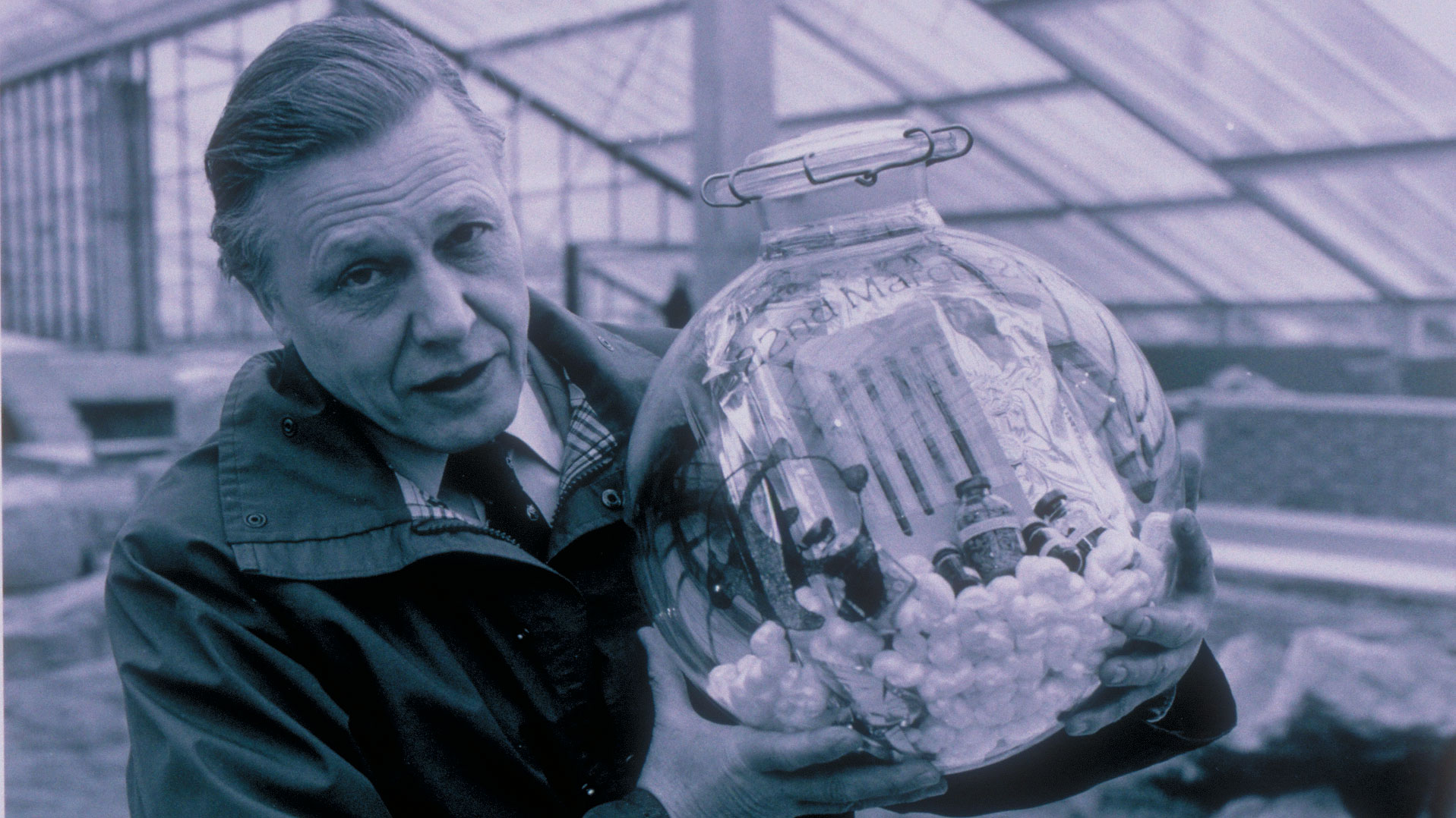 Sir David Attenborough in 1985 with the capsule now buried in the Princess of Wales Conservatory
