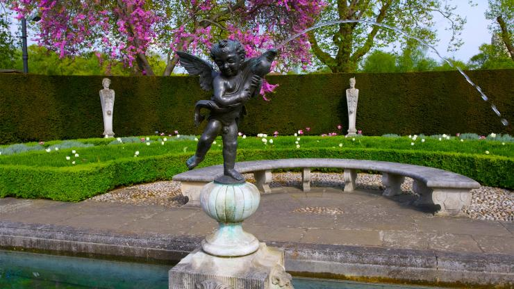 Cherub statue in the Queen's Garden at Kew