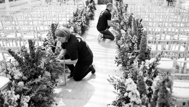 Arranging flowers in the Nash Conservatory