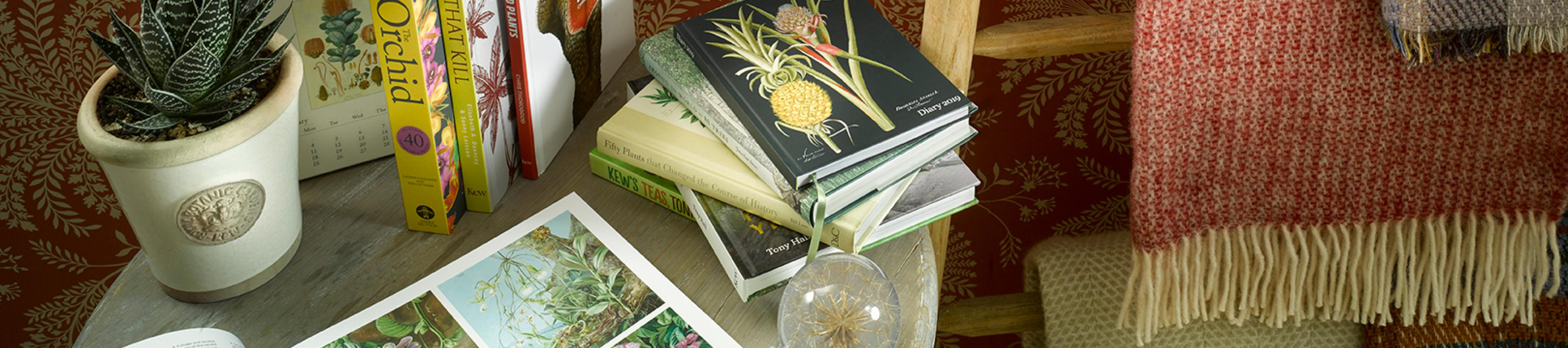 Books pulled on a coffee table along with a collection of Kew products