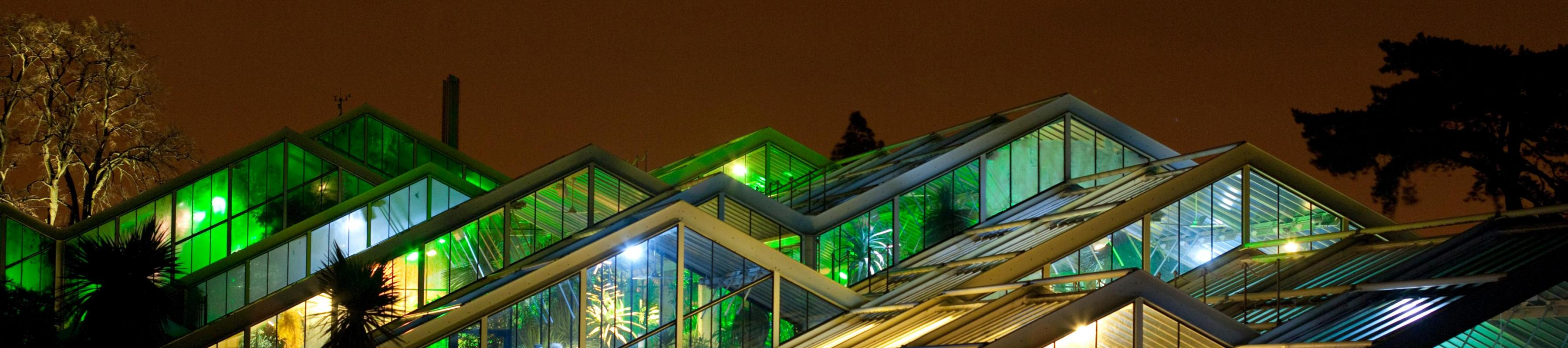 Princess of Wales Conservatory illuminated at night