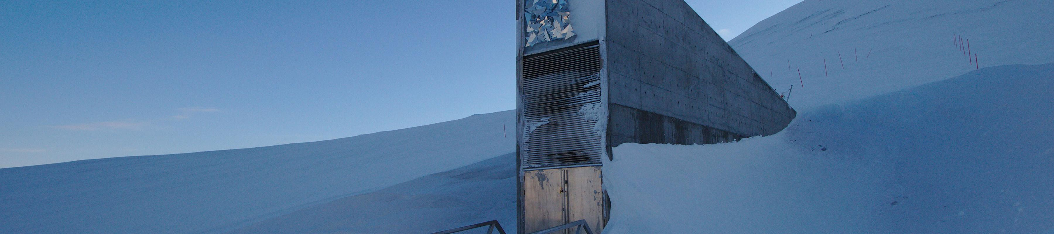 The futuristic-looking entrance to the Svalbard seed vault surrounded by snow