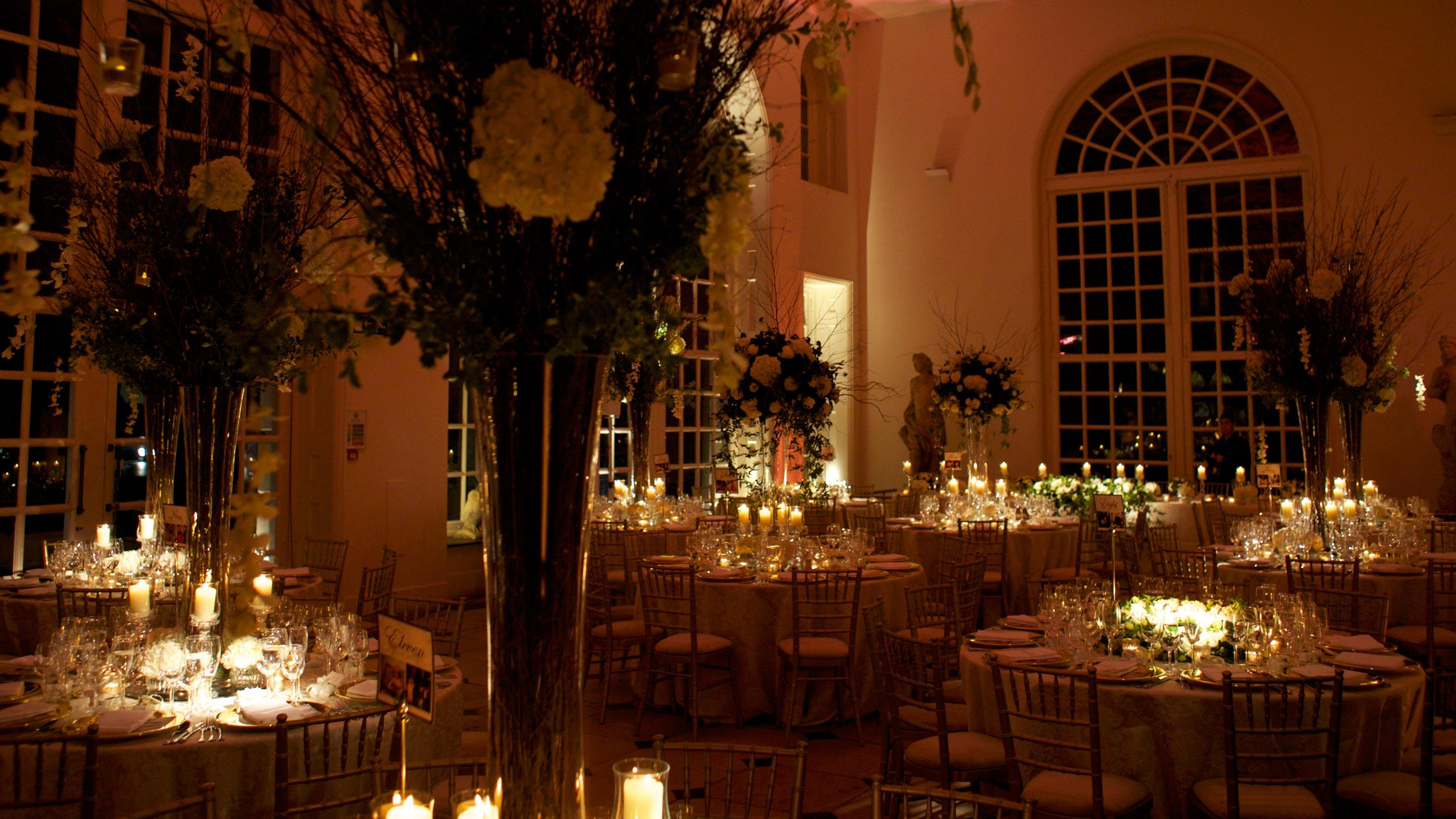 Orangery laid out for an evening wedding reception