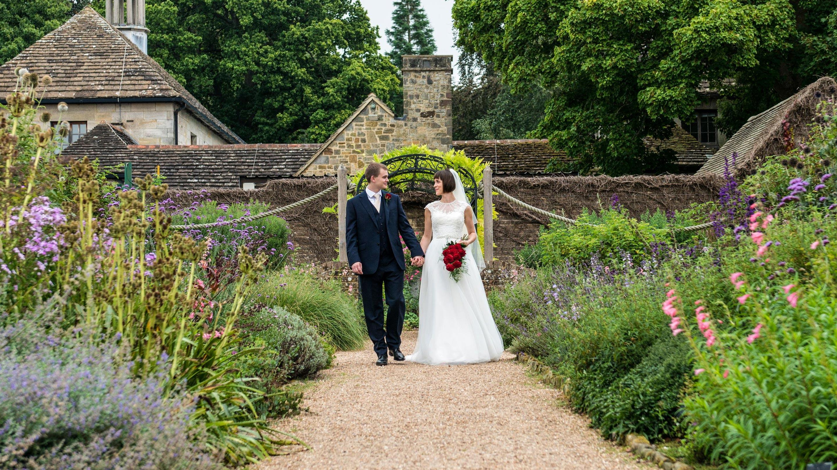 Wedding couple in the walled garden at Wakehurst
