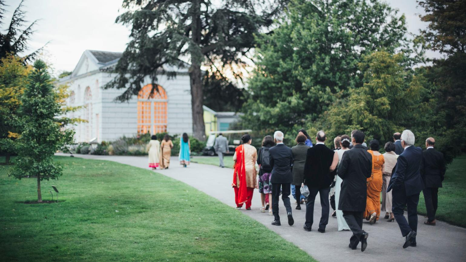 A wedding party walking to the Orangery