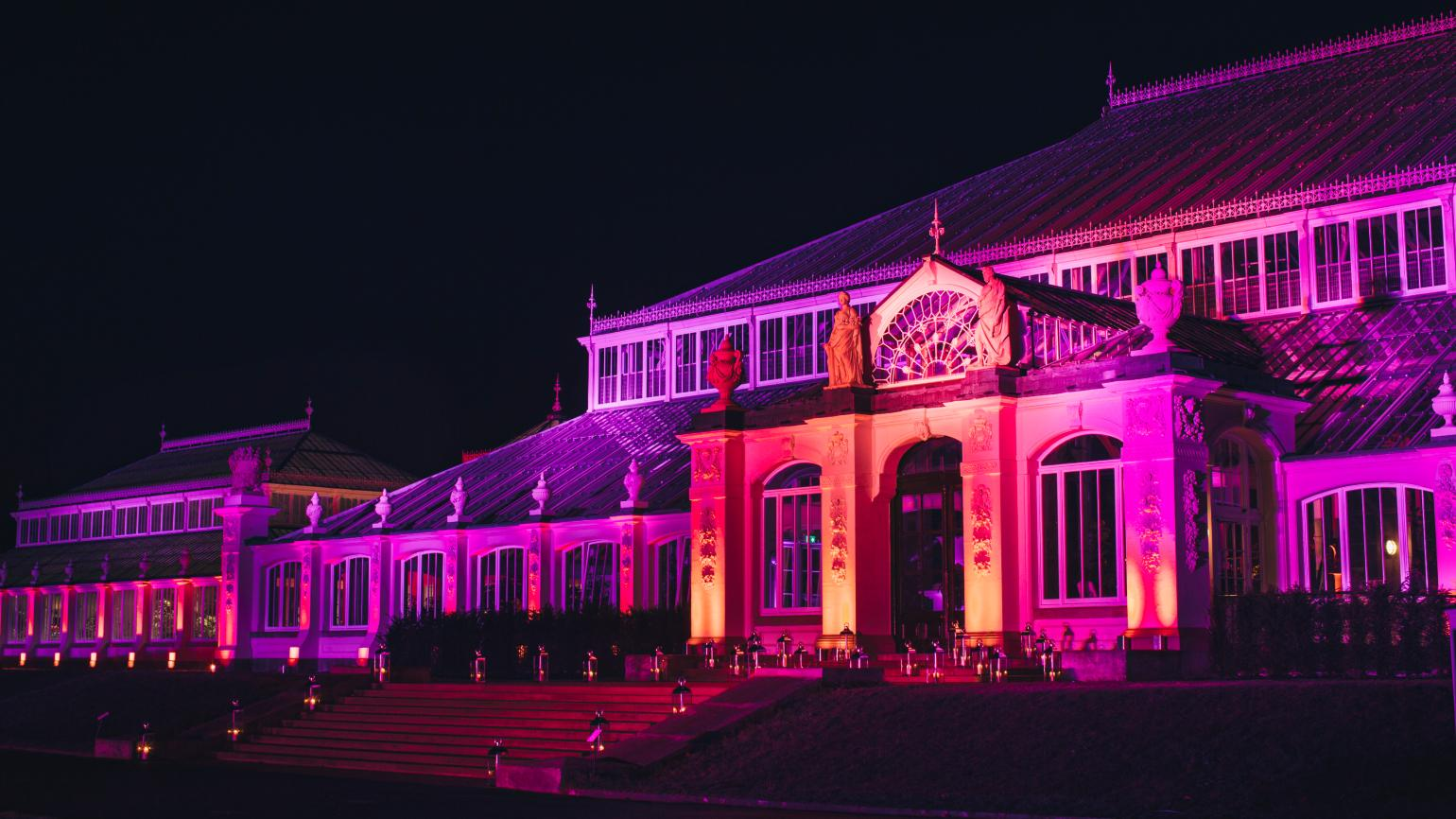 Temperate House illuminated at night