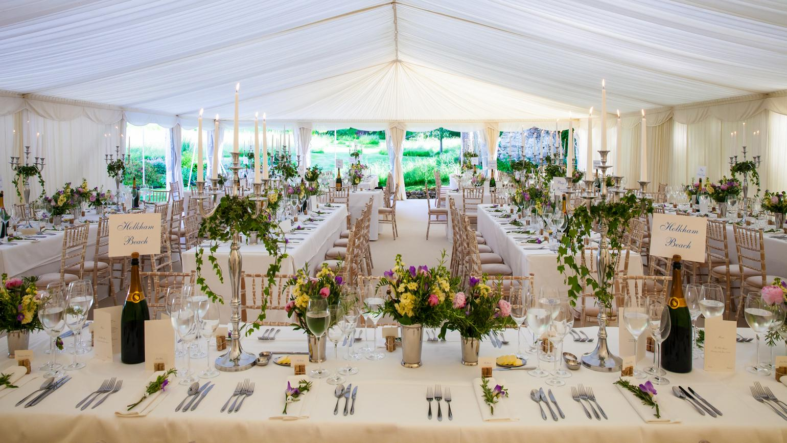 Beautiful table settings in a wedding marquee at Wakehurst