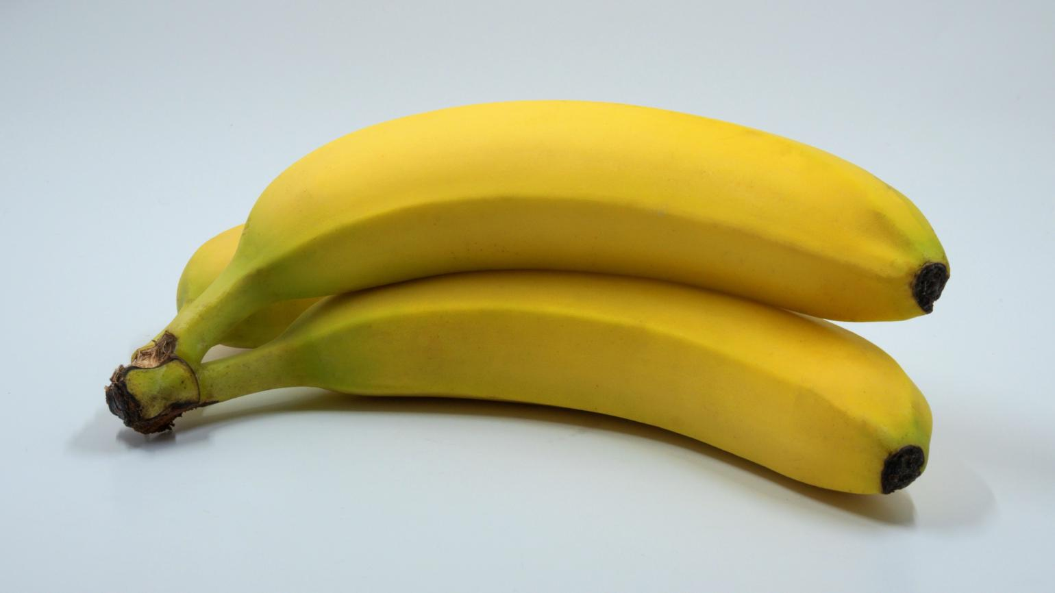 Slightly curved, yellow bananas