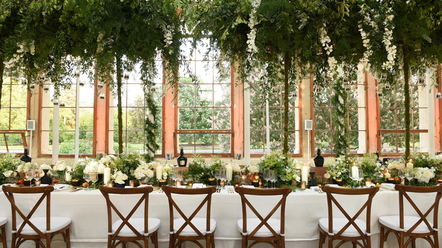 Table, chairs and flowers beautifully laid out in the Nash Conservatory for a wedding