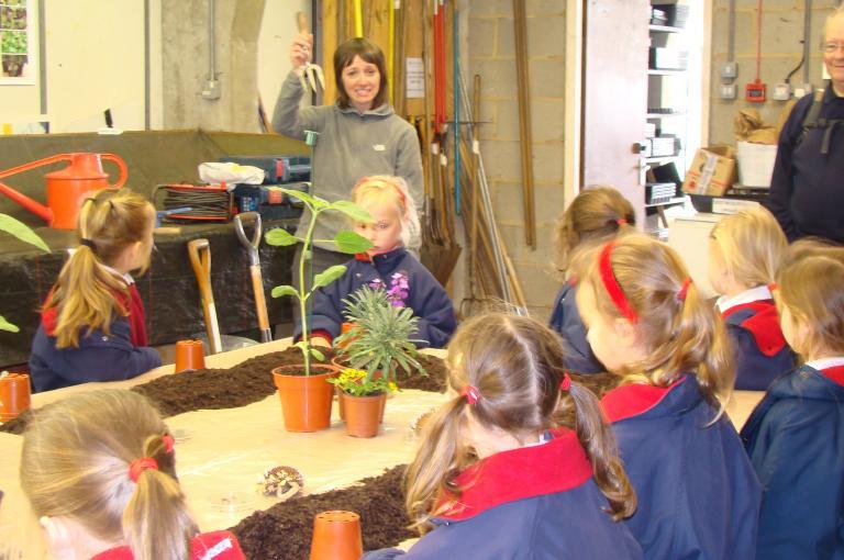 Potting seeds in the nursery at Wakehurst.