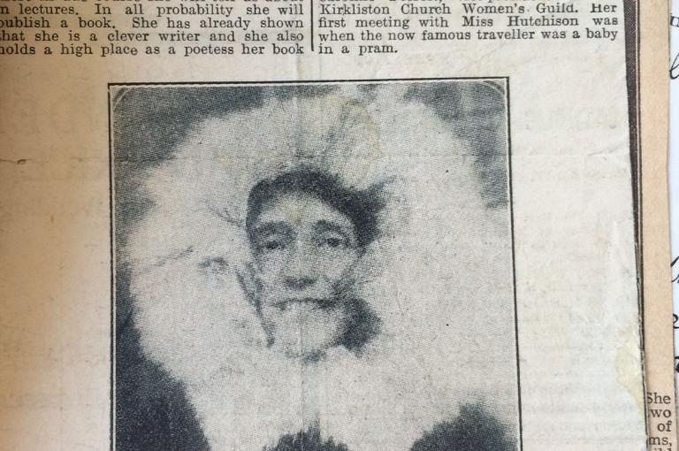 Newspaper clipping with photograph of Hutchins in fur lined coat