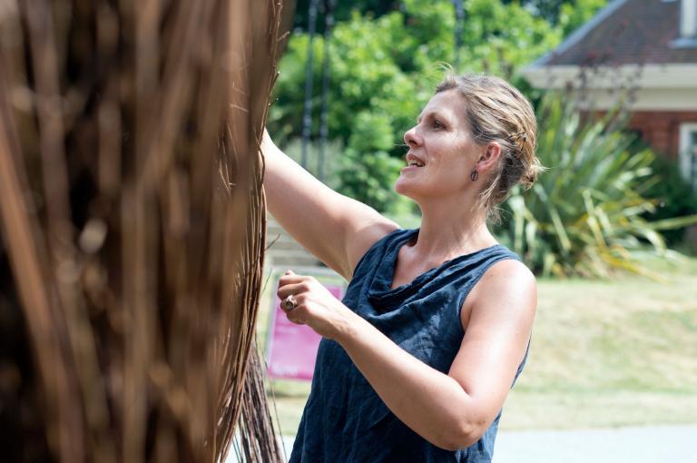 Julia Clarke creating her sculpture at Kew