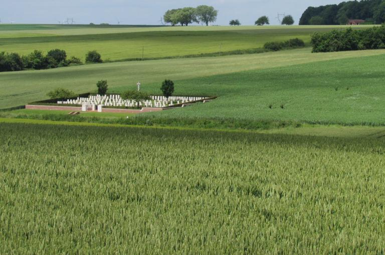 Thistle Dump Cemetery with the notorious killing ground of High Wood behind (Image: J. Wearn)