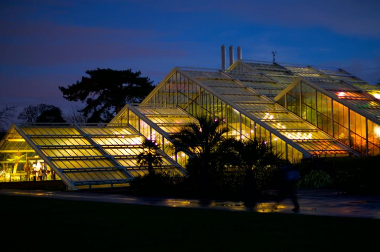 The Princess of Wales Conservatory lit up at night