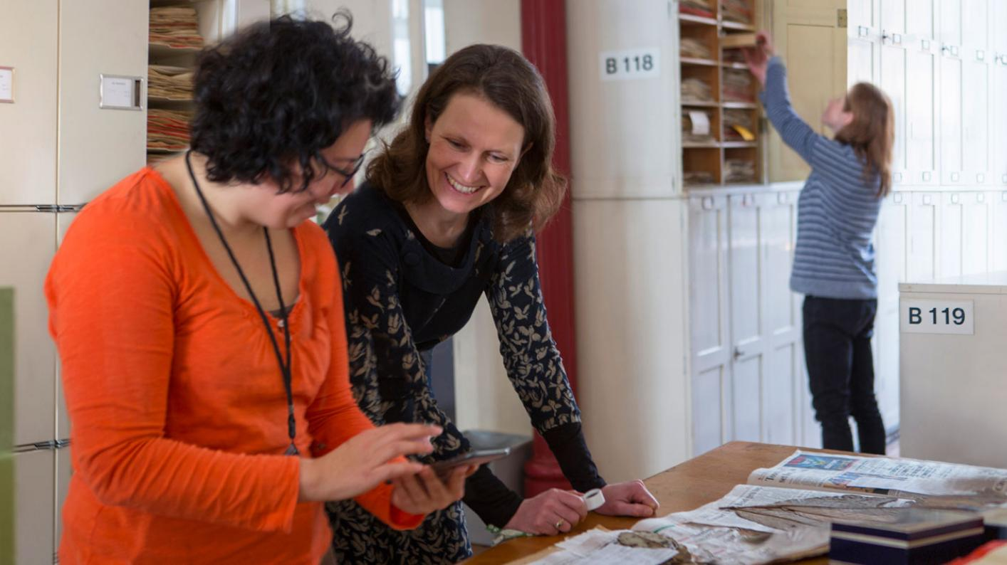 Researchers in Herbarium looking at specimens