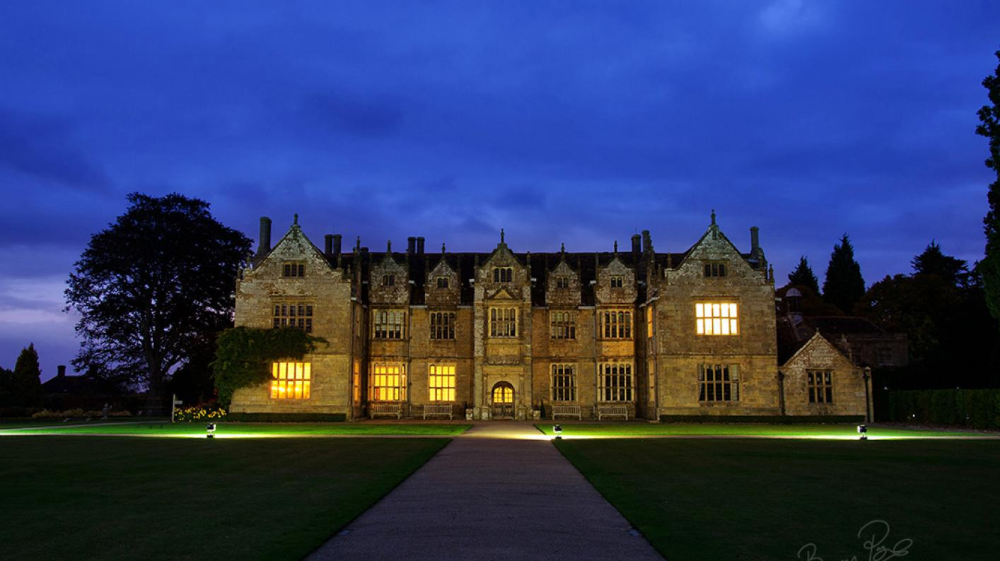 The Wakehurst Mansion at night