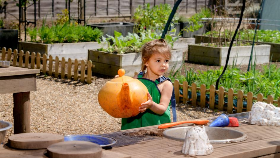 Children play in the mud kitchen