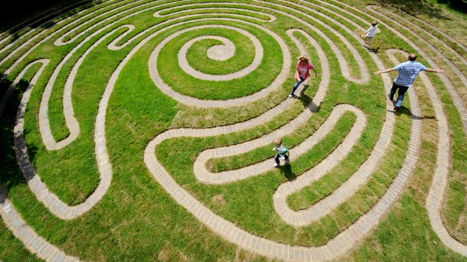 Children run through Labyrinth, Wakehurst