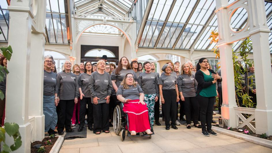 The choir singing in the Temperate House