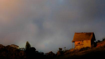 Dark cloudy sky with a hut