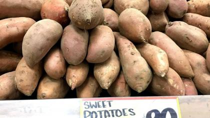Pile of sweet potatoes on sale in a shop