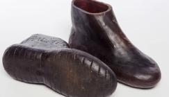 Photo of rubber shoes made from the latex of Hevea brasiliensis