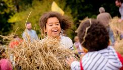 Children enjoy autumn games at Wakehurst