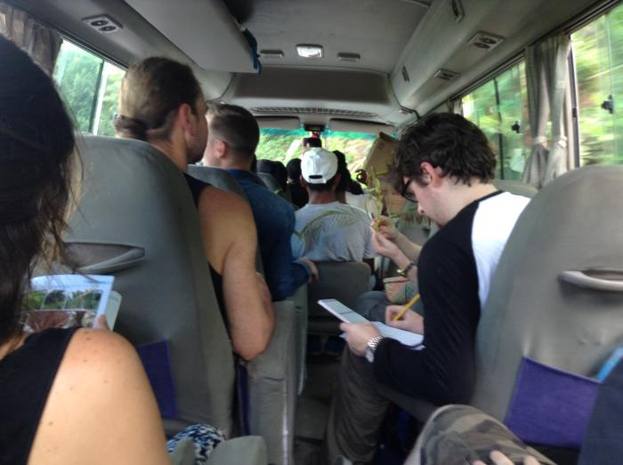 Image showing student on the road identifying plants using The Kew Tropical Plant Family Identification Book