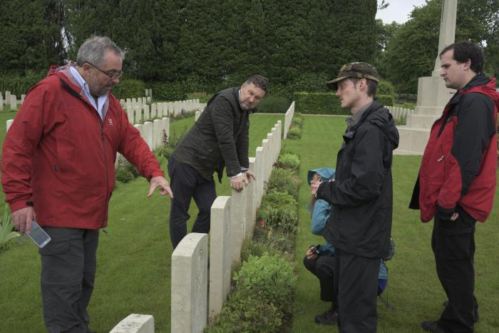Image showing Kew team discussing the planting with CWGC at Forceville Communal Cemetery